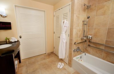 Accessible bathroom with ADA-compliant bathtub, grab bars