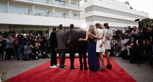 Beverly Hilton red carpet event attendees pose for photos