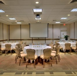 Three round tables arranged for a 25-person meeting in The Beverly Hilton Sunset Room